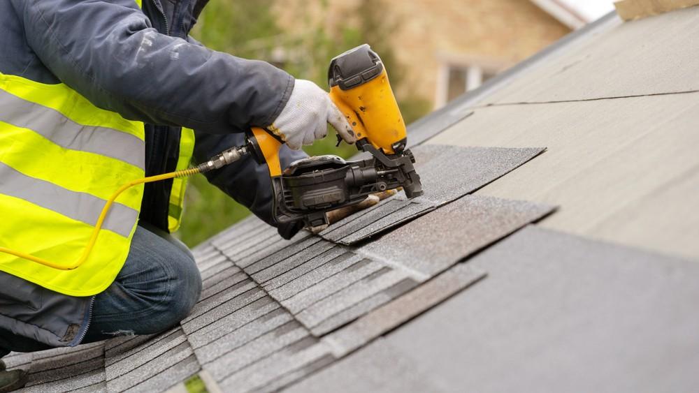 roofer applying shingle
