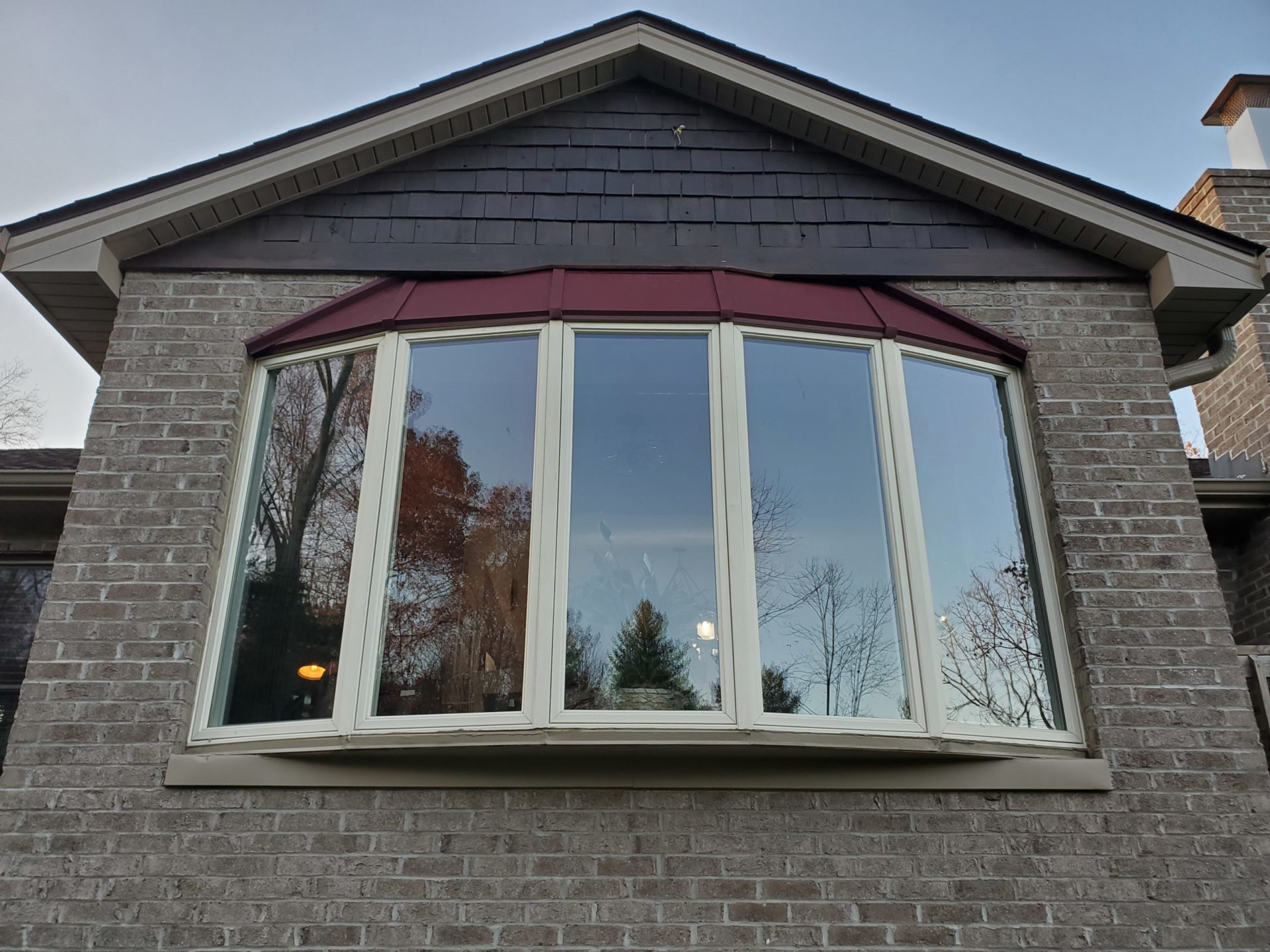 red metal roofing on window