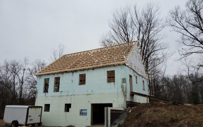 metal roof restoration process on barn